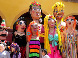 Mojigangas, the traditional enormous paper mache hollow figures (worn by paraders) were displayed along the edges of the Jardin. These also are the most creative of crafts indigenous to Mexico. (Image: Google)