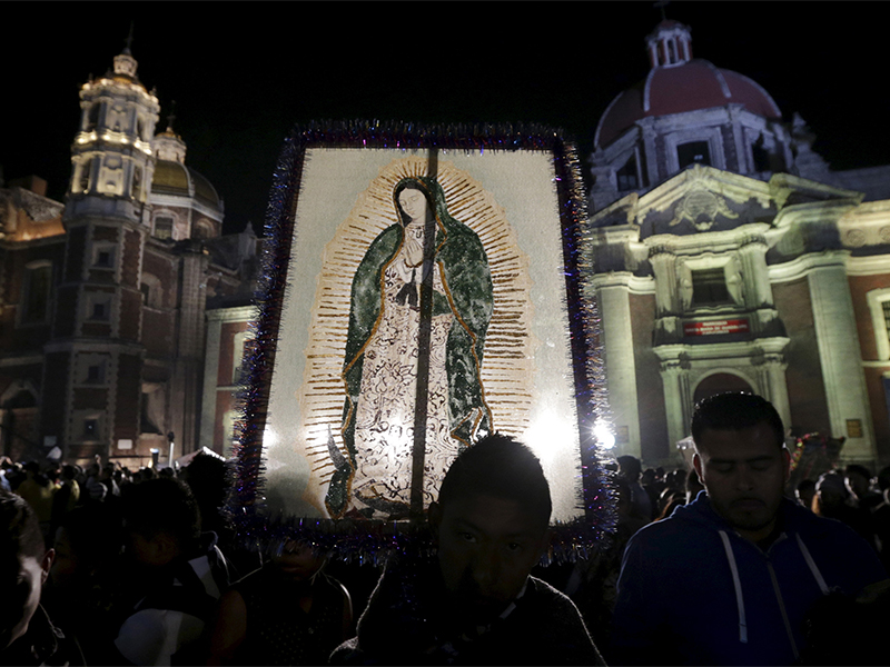 A pilgrim holds up an image of the Virgin of Guadalupe at the Basilica of Guadalupe during an annual pilgrimage in honor of the Virgin, the patron saint of Mexican Catholics, in Mexico City, Mexico on Dec. 12, 2015. Photo courtesy of Reuters/Henry Romero