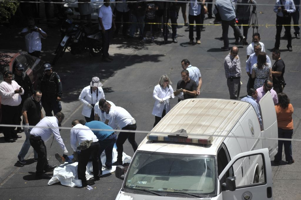 The body of Mexican journalist Javier Valdez is put on a stretcher by forensic personnel and investigators after he was shot dead in Culiacan, Sinaloa, Mexico, on May 15, 2017 The body of Mexican journalist Javier Valdez is put on a stretcher by forensic personnel and investigators after he was shot dead in Culiacan, Sinaloa, Mexico, on May 15, 2017 (AFP Photo/FERNANDO BRITO)