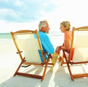 Retired couple on beach chairs on beach