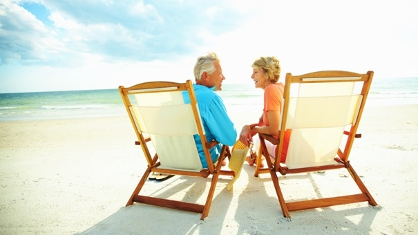 Retired couple on beach chairs on beach