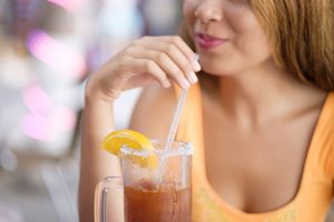 teenager-enjoying-a-michelada-drink-661773455-590242bd5f9b5810dcb0e80c