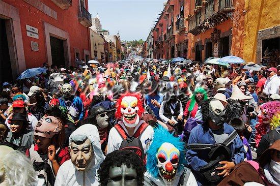 700-03005048 © RAW FILE Model Release: No Property Release: No Festival Goers Wearing Costumes at Los Locos Parade, San Miguel de Allende, Mexico