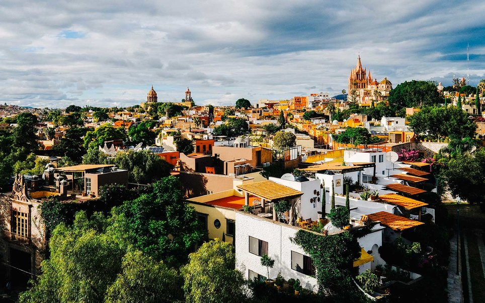There's a lot to love about San Miguel, a colonial treasure anchored by El Jardín, a leafy plaza marked by open-air cafés and the pink Parroquia de San Miguel Arcángel church. Art and textiles are big here: Mexicans and expats alike pop into independent boutiques selling artisan-made goods, and no trip is complete without a visit to the Fábrica La Aurora, a former textile factory that's been converted into a series of contemporary art galleries. Restaurants serving delicious Mexican dishes (rich moles, hot gorditas, stuffed chiles) are tucked along cobblestoned streets lined with historic houses. For one of the best views of the city, make a reservation at the Rosewood San Miguel de Allende's Luna Rooftop Tapas Bar (this hotel also ranked as the No. 2 City Hotel in the country); margaritas pair well with the chiming church bells at sunset.