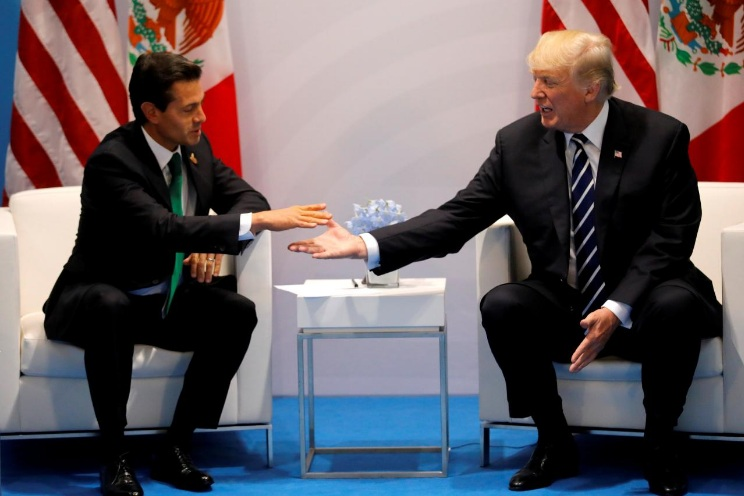 U.S. President Donald Trump shakes hands with Mexico's President Enrique Pena Nieto during the their bilateral meeting at the G20 summit in Hamburg, Germany July 7, 2017. (Reuters)