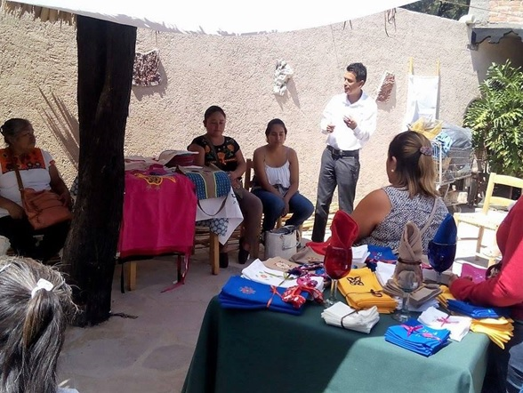 Mojica instructing and inspiring rancho women to achieve their goals with their embroidery talents.