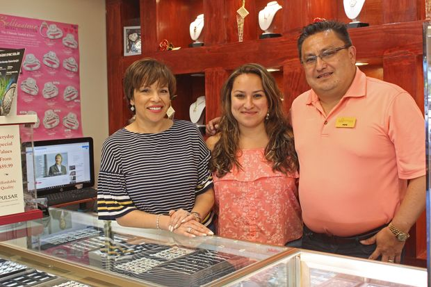 """Jose """"Pepe"""" Torres Jr. (right), Jr. stands next to his daughter Cynthia and wife Norma (left)."""