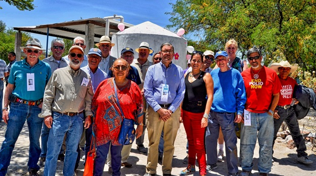 Local Rotarians and a campesino with a completed rain-harvesting cistern