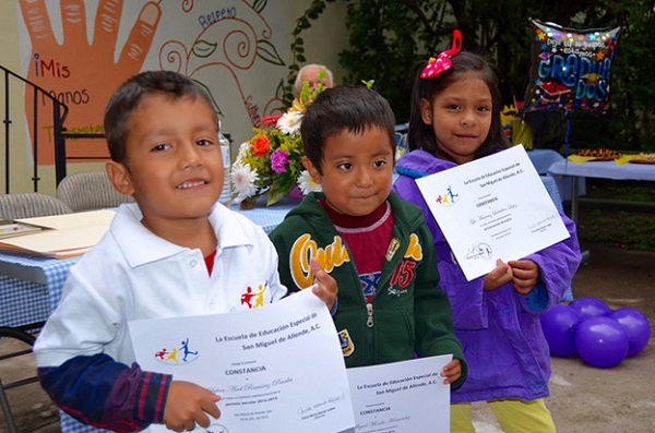 Young students with hearing disabilities proudly exhibit their EEE certificates of achievement. (Photo: Robin Loving)