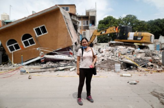 "Ana Maria Hernandez Ana Maria Hernandez, 37, a clothing salesperson, poses for a portrait outside her house as it is demolished after an earthquake in Jojutla de Juarez, Mexico, September 30, 2017. Her house was badly damaged. Hernandez is living with relatives and hopes to return home once it is rebuilt. ""I lost everything. My aunt died here,"" she said. (Photo: Edgard Garrido/Reuters)"