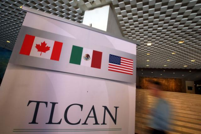 A NAFTA banner is seen during the fifth round of NAFTA talks involving the United States, Mexico and Canada, in Mexico City, Mexico, November 18, 2017. REUTERS/Edgard Garrido