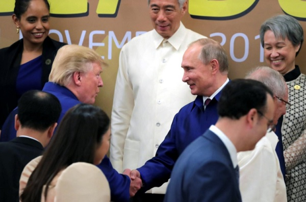 U.S. President Donald Trump and Russian President Vladimir Putin shake hands as they take part in a family photo at the APEC summit in Danang, Vietnam November 10, 2017. Sputnik/Mikhail Klimentyev/Kremlin via REUTERS