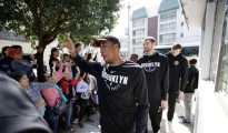 Rondae Hollis-Jefferson and some of his Nets teammates greeting fans in Mexico City on Wednesday. The Nets played two regular-season games there last week. (Photo: Rebecca Blackwell/Associated Press)